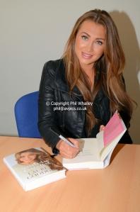 Lauren signing copies of her book