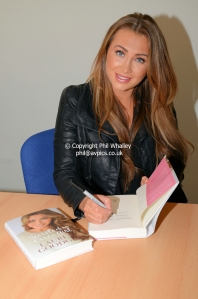 Lauren signing copies of her book
