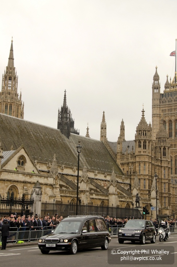 The hearse carrying Baroness Thatcher leaves Parliament.