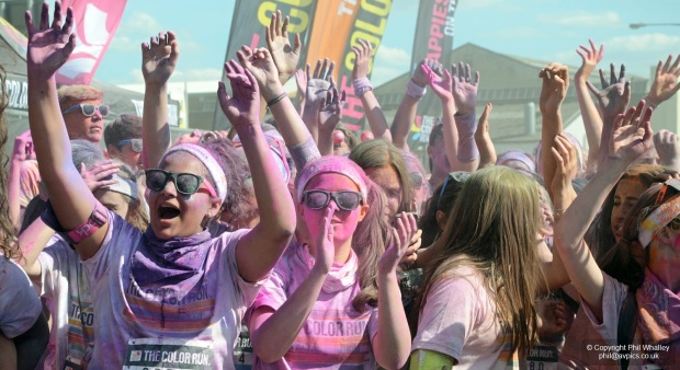 Wembley Park, London, UK - 7 June 2015. Known as 'the happiest 5k on the planet', The Color Run is an un-timed celebration of health and colour, meaning groups of friends can walk, jog, dance and party their way along the course at any pace. At each kilometre, colour explosions cover runners in kaleidoscopic powder. First held in the US in January 2012 'The Color Run' has since spread around the world. The event attracted 19,000 runners